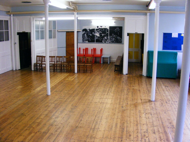 Photo of the Saltcellar with polished wooden floor, chairs, and small tables